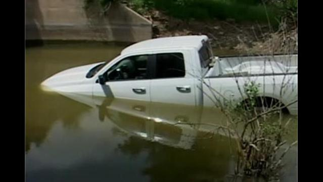 Distracted Driving Sends Driver Up a Creek