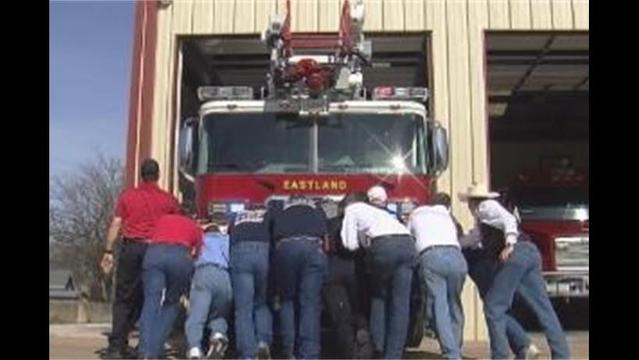Eastland Firefighters Push 75k lb. Ladder Truck Into Its New Home