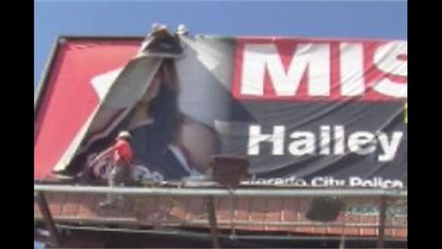 People Gather as Hailey Dunn 'Missing' Billboard Comes Down