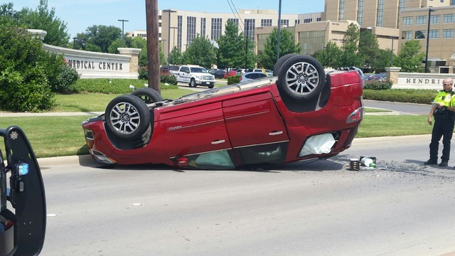 Car Drives Up Telephone Pole Wire, Rolls Over in North Abilene