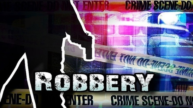 Armed robber takes cash, cigarettes from Abilene service station