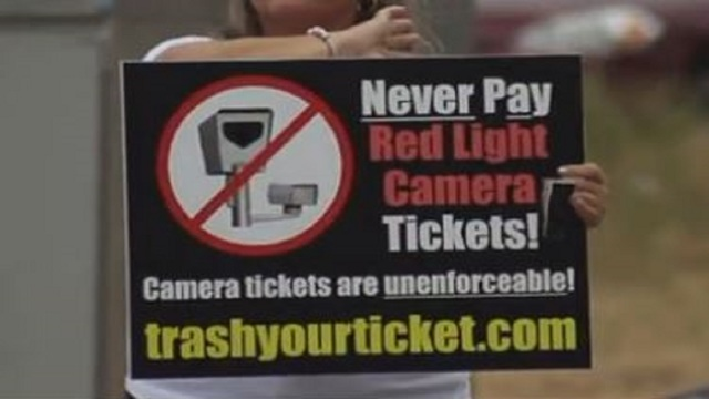 Red light cameras across Texas could be operating illegally