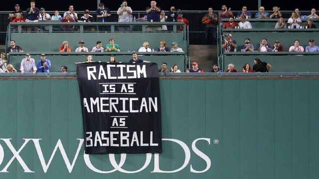 Fenway Park security confiscate 'racism is as American as baseball' fan banner