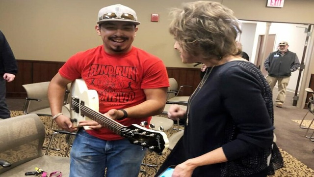 Guitar from band America gifted to TSTC student who lost everything in fire