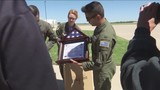 Dyess presents flags to Cisco FD, Greg Simmons Airport